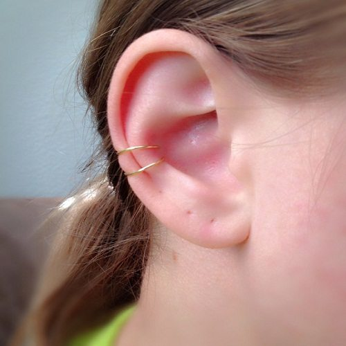 outer-conch-piercing-with-double-gold-ring