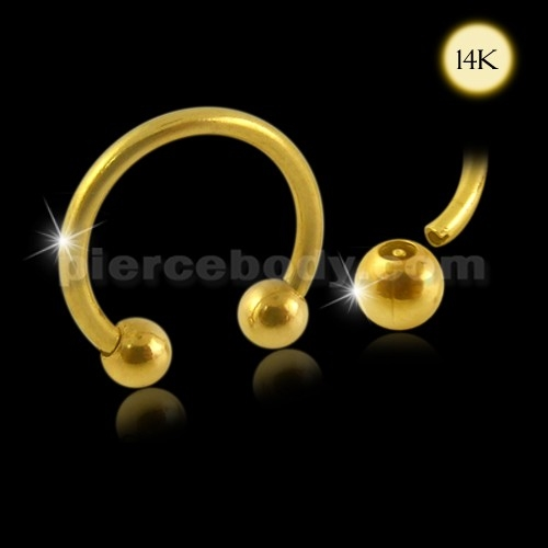 gold circullar barbell